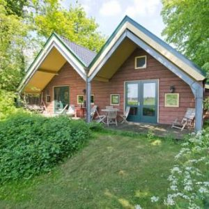 Chalet with a Meadow view in Een